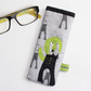 Monochrome dog print glasses case with appliqué dog with green ears and tail