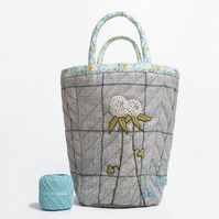 Big grey checked project bag with hand embroidered clover and bluebells