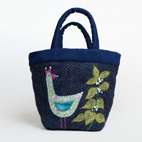 Navy tweed project bag with hand embroidered bird and dead nettle