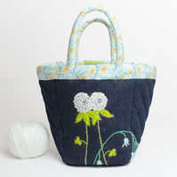 Black denim project bag with hand embroidered clover and bluebell