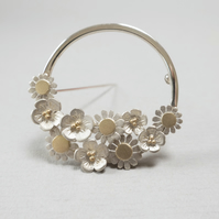 Circular flower brooch