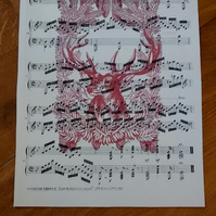 Vintage stag print on vintage music sheet in rusty red