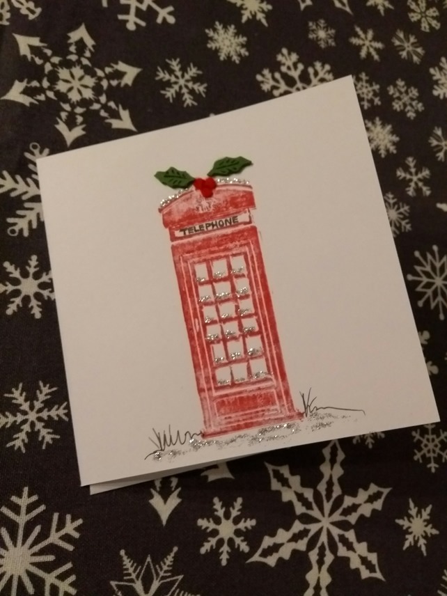 Handprinted linocut red telephone box christmas card