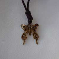 Butterfly Pendant in Copper on a Purple Cord