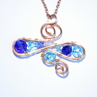 Blue glass bead and crystal swirling OOAK pendant wrapped in copper wire