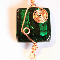 Deep green square glass foiled bead wrapped with spirals of copper wire