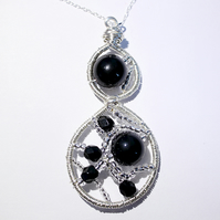 Black and silver wire wrapped and woven pendant with sterling silver chain