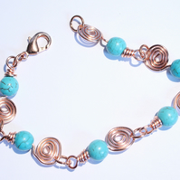 Turquoise and copper spirals bracelet