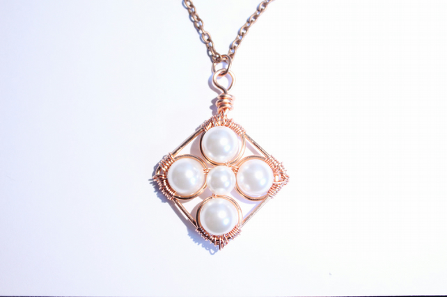 Copper and white crystal pearl cross pendant