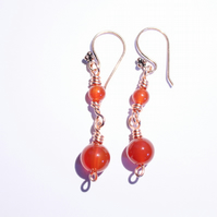 Rich orange carnelian and copper dangle earrings
