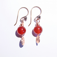 Tawny orange carnelian and Celtic copper spiral dangle earrings