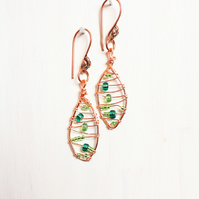 Autumnal copper leaf shaped wire wrapped drop earrings with green seed beads