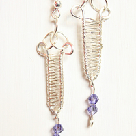 Silver wire wrapped dagger earrings with tanzanite crystal dangles