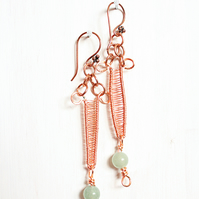 Copper wire wrapped dagger earrings with pale green aventurine bead dangles