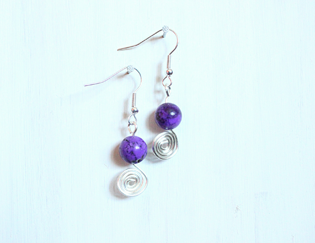 Purple dyed howlite and silver spiral dangle earrings