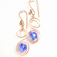 Dark blue faceted glass bead and copper S spiral dangle earrings