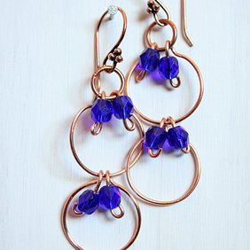 Dark blue faceted glass bead and copper multi link dangle earrings