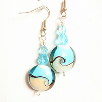 Blue and cream round lampwork bead dangle earrings with blue faceted glass beads