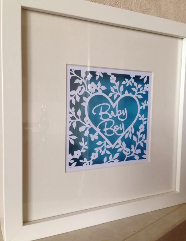 Baby boy paper cut in white box frame. New baby gift.