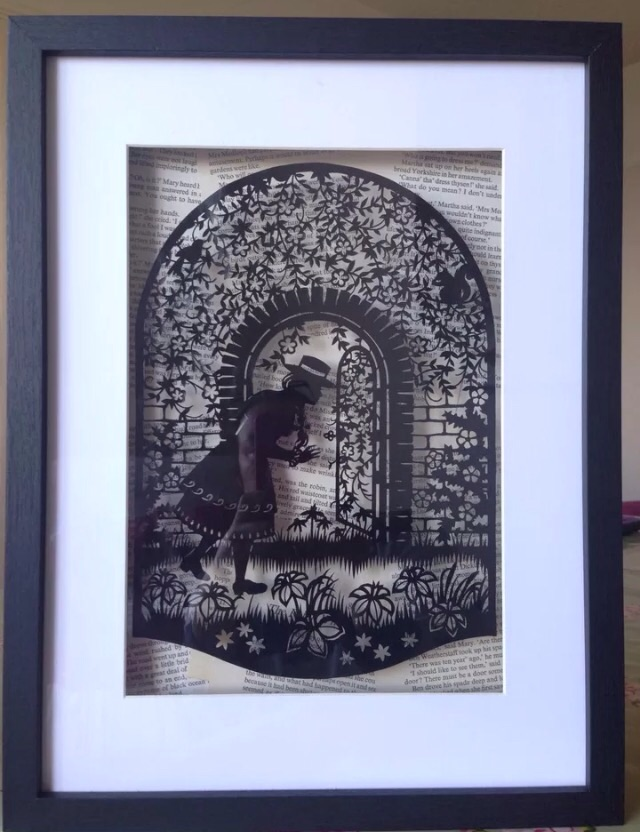 Large Framed Paper Cut, The Secret Garden Floating Over Vintage Book Pages.