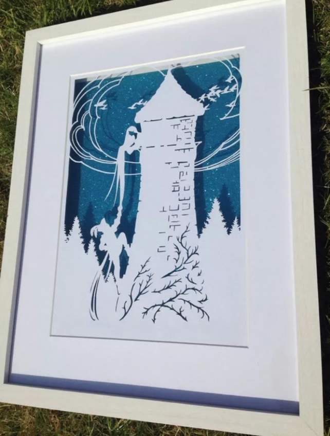Large Paper Cut Of Rapunzel. Box Framed Floating Over Glitter Background.