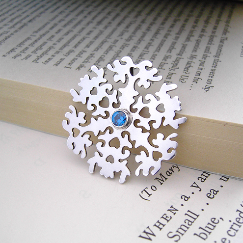 snowflake pendant with blue sapphire