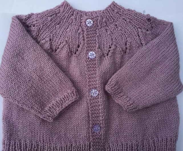Hand knitted baby girls cardigan in Pink