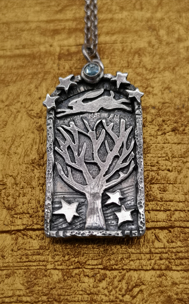 Hare Pendant with Tree and blue topaz