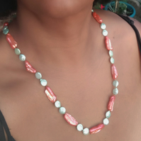Citrus orange and green baroque freshwater pearl necklace. 27 inches, 74 cm