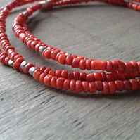Beaded bangles with brick red and metallic beads