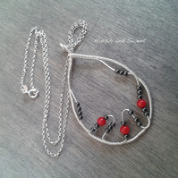 Wire-wrapped pendant necklace with hematite and coral