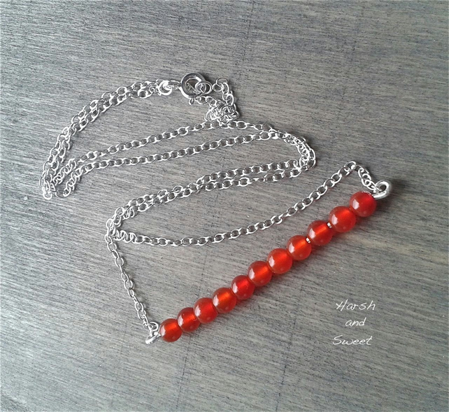 Sterling silver bar necklace with burnt orange carnelian