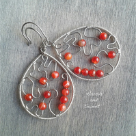 Wide dangle earrings with burnt orange carnelian