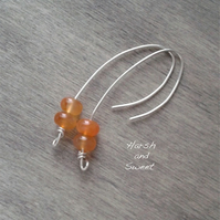 Long drop earrings with burnt orange carnelian gemstone