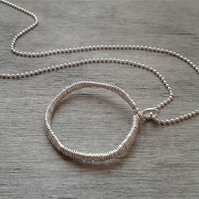 Sterling silver necklace with open circle pendant