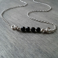 Short silver necklace with onyx beaded bar