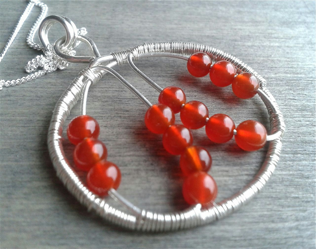 Statement necklace with wire wrapped pendant with carnelian gemstone
