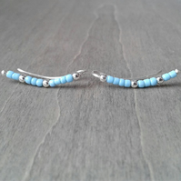 Long ear climbers with small turquoise glass beads