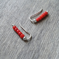 Small ear creepers with brick red glass beads
