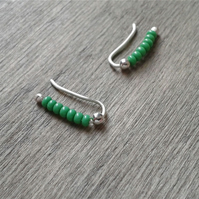 Small ear crawlers with green glass beads