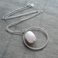 Multi pendant necklace with rose quartz and open circle pendants