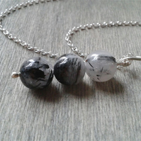 Sterling silver necklace with black and white rutilated quartz bar pendant