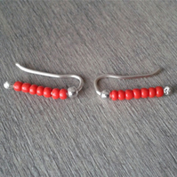 Beaded ear cuffs with red glass beads