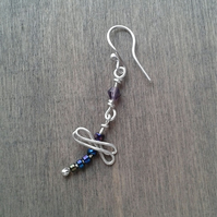 Long drop earring with dragonfly
