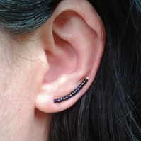 Earring crawlers with dark glass beads