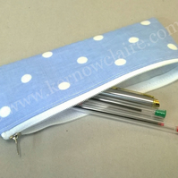 Pencil case in pale blue oilcloth with spots