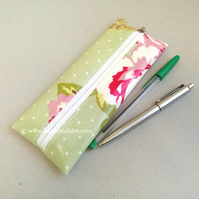 Pencil case in pale green with pink flowers