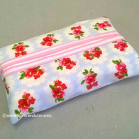 Tissue holder in pale blue with pink flowers, tissues included