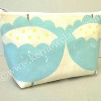 Make up bag in cream with large blue flowers
