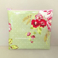 Make up bag in pale green oilcloth with pink flowers